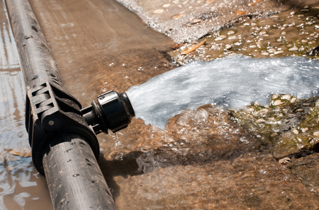 water gushing out of the pipeline during construction