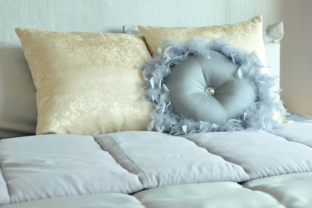 Classic and elegant blue tone color pillows setting on the bed