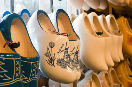 Colorful vintage Dutch wooden clogs in a shop. Stock Photo
