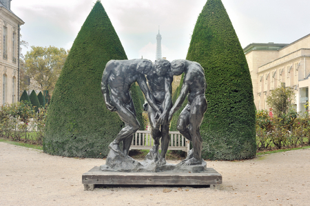 Paris, France - November 9, 2017.  The Three Shades statue with Effel and garden of The Rodin Museum  in Paris. Editorial
