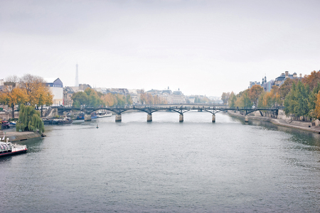 Panorama view of the bridge Pont des Arts and river Seine in Paris, France in the winter season.