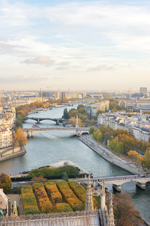 View of Paris skyline, Seine river and bridges seen from the top of Notre Dame cathedral. 스톡 콘텐츠 - 126700463