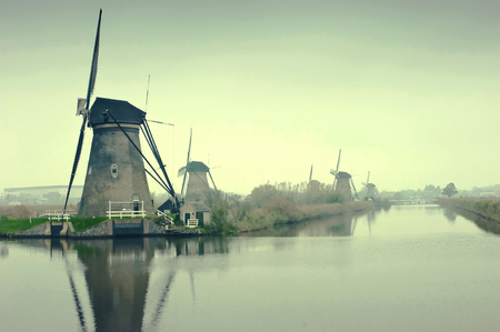 The Famous Netherlands wooden Windmills,  Kinderdijk Windmill village in the soft sunset light of winter.