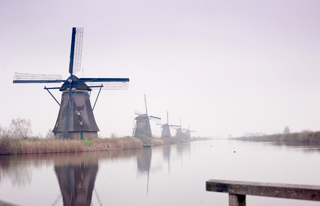 The Famous Netherlands wooden Windmills, , Kinderdijk Windmill village in the soft sunset light of winter.