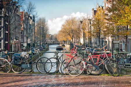 Scenic of  bridge with bicycles parked over the canals of Amsterdam, Netherlands. 스톡 콘텐츠