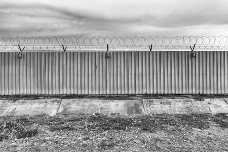 prison guard: Barbed fence for authorized and protect have three lamp Stock Photo