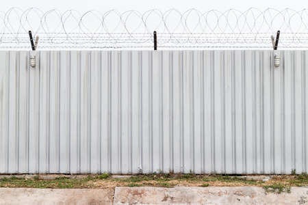 prison guard: Barbed fence for authorized and protect have two lamp Stock Photo