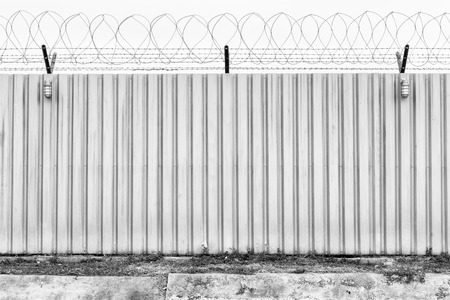 jail break: Barbed fence for authorized and protect have two lamp Stock Photo