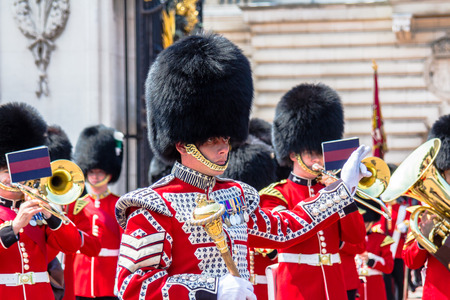 buckingham palace: Guard Change Times at Buckingham Palace, Loandon. Time 11:15 Guards,with bands start arring. Time11:30 Official start time. Time 12:00 Guard change ceremony ends Editorial