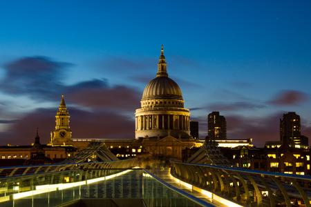millennium bridge: Night at Millennium Bridge and St.Paul Cathedral Stock Photo