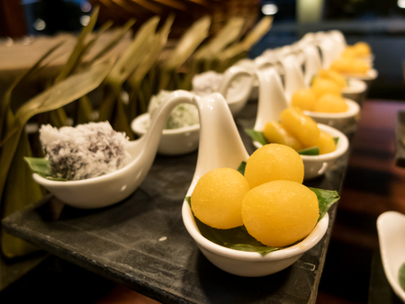 yoke: Buffet food and dessert, egg yoke fudge balls cooked in syrup and Coconut Ball Stock Photo