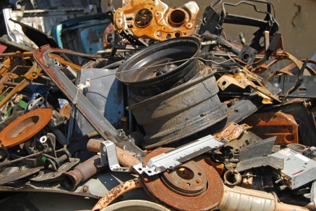discarded metal: Scrap heap of used automobile parts as background Stock Photo