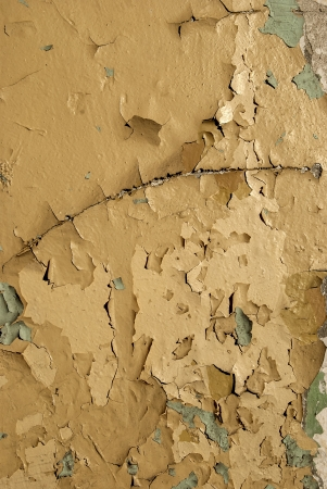 crumbling: Old crumbling paint layers wall as background Stock Photo