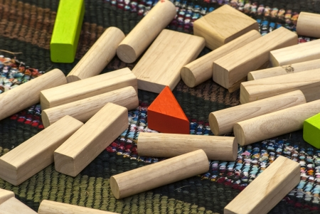 non  toxic: Elements of children s wooden sorting and stacking toys on homemade rug