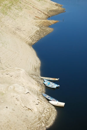 receded: Top view of receded dam waters and boats