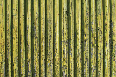 laths: Weathered wooden surface with nailed laths and faded paint