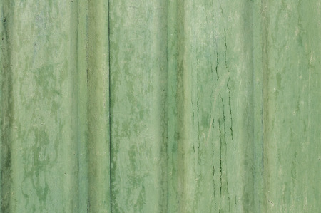 Painted grunge green tin wall suface as background