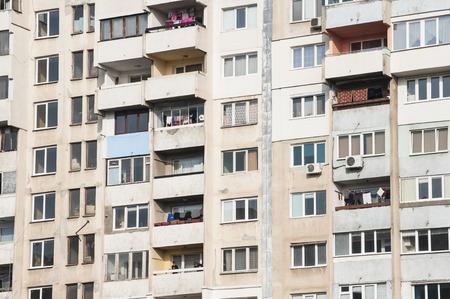 residential neighborhood: Large obsolete residential appartment block in a poor neighborhood