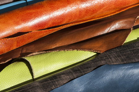 coined: Coined in rolls processed color leather for leather manufacture Stock Photo
