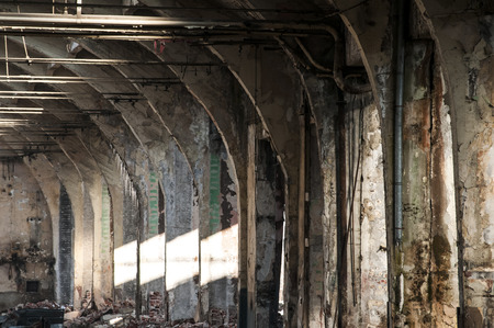 decayed: Old abandoned decayed grunge hall of vintage railway plant inside Stock Photo