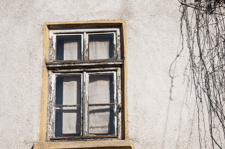 abandonment: Old weathered grunge window of neglected abandoned townhouse facade Stock Photo