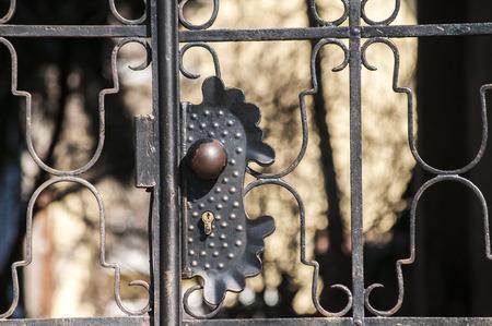 patio: Lock on metal grid on closed black patio door closeup