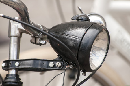 headlight: Black colored retro vintage bicycle headlight closeup