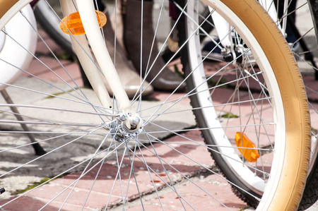 spokes: Front bicycle wheels with metal spokes closeup Stock Photo