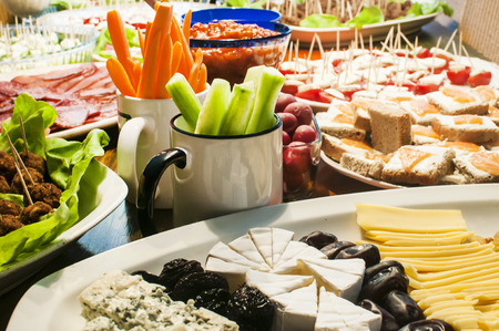 Home table with variety of appetizer dishes at party Stock Photo