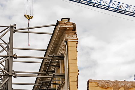 preservation: Technology to build new office building construction with preservation of old facade