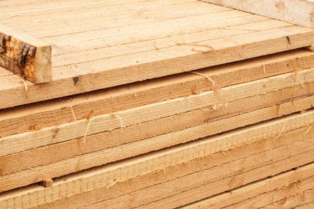 limber: Cut in boards and trim for sale pine wooden material closeup in lumberyard