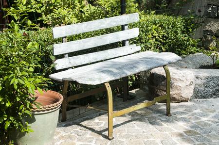 garden bench: Old wooden garden bench in house backyard
