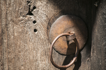 fittings: Rusty iron fittings hardware of old weathered wooden board of door