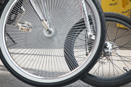 spokes: Two bicycle front wheels with spokes closeup