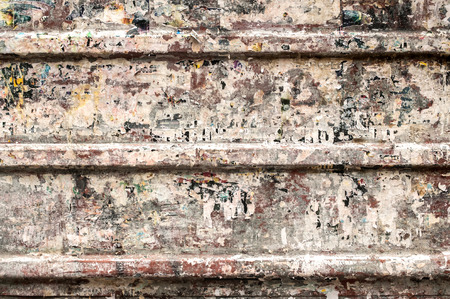 corrugated steel: Metal grunge panel of corrugated steel with remains of glued posters as background Stock Photo