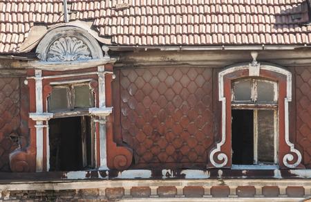 neglected: Grunge broken windows of old neglected abandoned vintage building