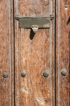 Slot in mailbox on old vintage wooden door Stock Photo