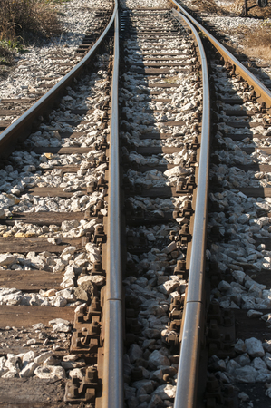 wood railroad: Railroad iron rails old sleepers and gravel closeup Stock Photo