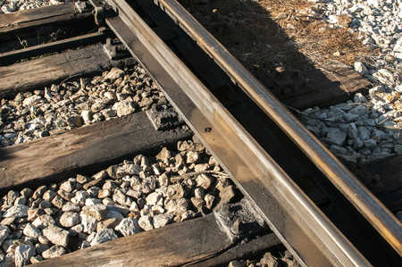 Railroad iron rails old sleepers and gravel closeup Stock Photo