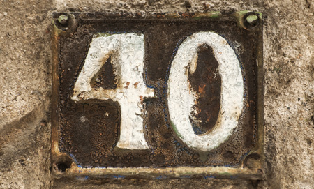 Old retro weathered cast iron plate with number 40 Stock Photo