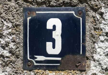 enameled: Weathered grunge square metal enameled plate of number of street address with number 3 closeup Stock Photo