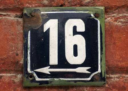 number 16: Weathered grunge square metal enameled plate of number of street address with number 16 closeup Stock Photo
