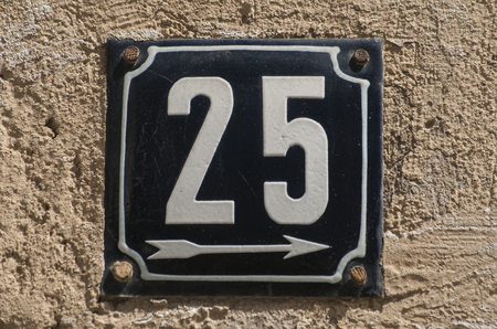 25: Old retro weathered cast iron plate with number 25 Stock Photo