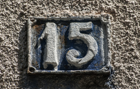 15: Old retro weathered cast iron plate with number 15
