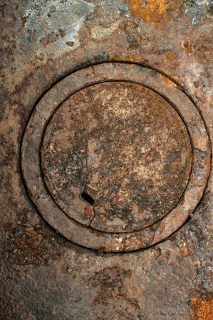 cast iron: Rusty weathered antique cast iron wood stove burner cover plates