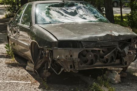 abandoned car: Abandoned damaged broken crashed car closeup Stock Photo