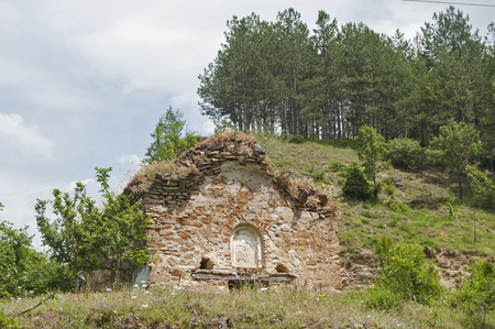 crumbling: Abandoned crumbling medieval chapel exterior in mountains landscape