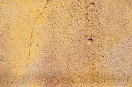 stucco house: Old grunge weathered house wall stucco surface with paled paint closeup as background
