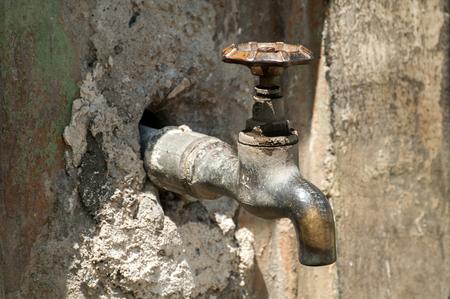 waterpipe: Weathered grunge tap water valve crane closeup