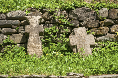 stone tombstone: Old stone tombstone crosses on stone wall background